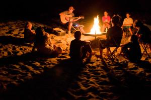 Idaho. Lower Salmon River. Playing guitar around campfire. MR